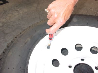 Picture of removing the valve core from the tire